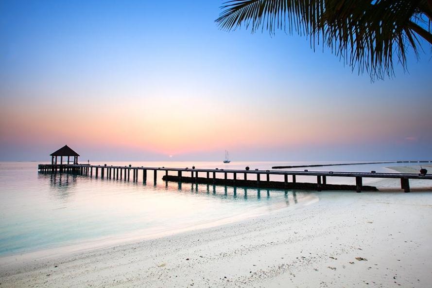 sunrise on the island of komandoo in the maldives