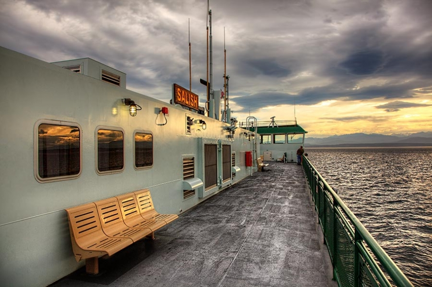 sunset on the ferry from whidbey island to port townsend in the pacific northwest of the usa