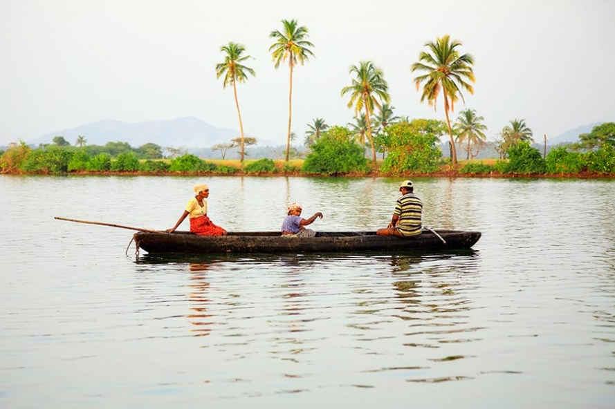 local goan family fishing in a canoe on the river sal near Cavelossim in Goa