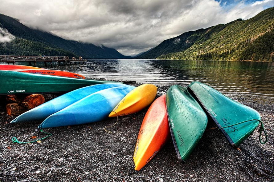 lake crescent with kayaks on the shore in the foreground
