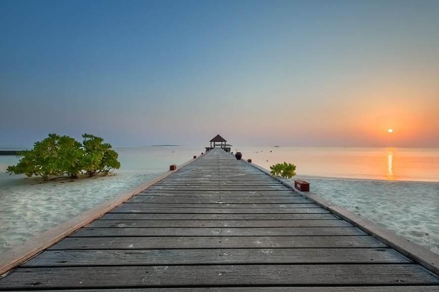 sunrise at the jetty on the island of komandoo in the maldives