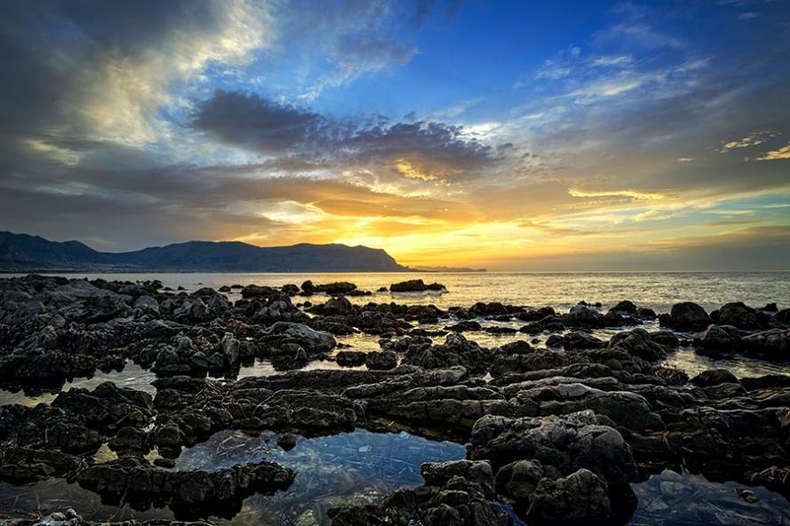 sunset at isola delle femmine in sicily