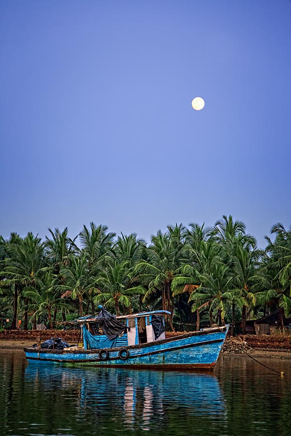 fishing boat on the river sal in goa, india
