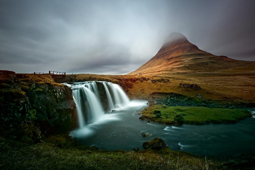 Kirkjufellfoss waterfall and the mountain Kirkjufell in Iceland